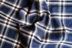 Textile background with a checkered blue napkin, top view. Natural textile background. Fabric texture background. Texture of natur. Al linen fabric royalty free stock image