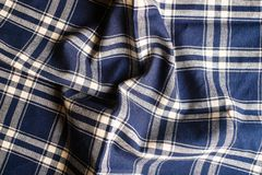 Textile background with a checkered blue napkin, top view. Natural textile background. Fabric texture background. Texture of natur. Al linen fabric royalty free stock photo