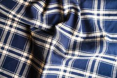 Textile background with a checkered blue napkin, top view. Natural textile background. Fabric texture background. Texture of natur. Al linen fabric stock images