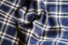 Textile background with a checkered blue napkin, top view. Natural textile background. Fabric texture background. Texture of natur. Al linen fabric stock image