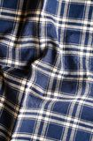 Textile background with a checkered blue napkin, top view. Natural textile background. Fabric texture background. Texture of natur. Al linen fabric royalty free stock photography