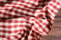 Textile background with a checkered red napkin, top view. Natural textile background. Fabric texture background. Texture of natura. L linen fabric royalty free stock photos