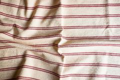Textile background with a checkered red napkin, top view. Natural textile background. Fabric texture background. Texture of natura. L linen fabric stock photo