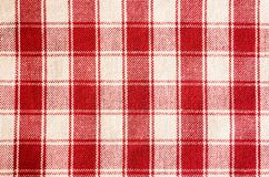 Textile background with a checkered red napkin, top view. Natural textile background. Fabric texture background. Texture of natura. L linen fabric stock photography