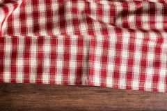 Textile background with a checkered red napkin, top view. Natural textile background. Fabric texture background. Texture of natura. L linen fabric royalty free stock photo