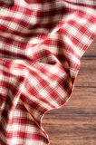 Textile background with a checkered red napkin, top view. Natural textile background. Fabric texture background. Texture of natura. L linen fabric royalty free stock images