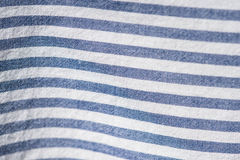 Textile background from a fabric with blue and white stripes Stock Photos