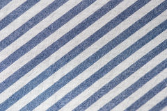 Textile background from a fabric with blue and white stripes Stock Images