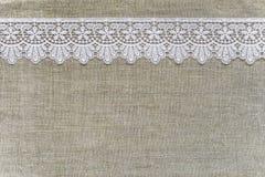 Textile background. Lace border over unpainted burlap stock photos