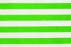 Textile background with lime green and white stripes. Fabric texture Stock Photo