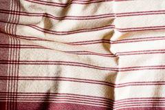 Textile background with a red striped linen napkin, top view. Natural textile background. Fabric texture background. Texture of na. Tural linen fabric royalty free stock image