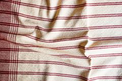 Textile background with a red striped linen napkin, top view. Natural textile background. Fabric texture background. Texture of na. Tural linen fabric stock images