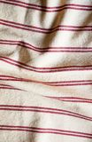 Textile background with a red striped linen napkin, top view. Natural textile background. Fabric texture background. Texture of na. Tural linen fabric stock photography