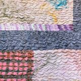 Various sewn pieces of patchwork cloth royalty free stock photo