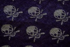 Textile background with skulls Stock Image