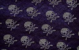 Textile background with skulls Stock Photography