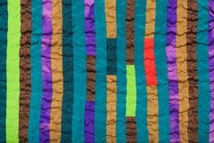 Stitched patchwork scarf from narrow silk strips Royalty Free Stock Photos