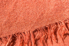 Textile background terracotta color with fringe Stock Photos