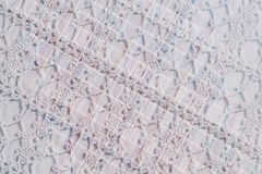 Textile background  in vintage style -- flannel, cotton into the classic cell and vintage homemade knitted lace of crochet napkins Stock Image