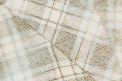 Textile background  in vintage style -- flannel, cotton into the classic cell and vintage homemade knitted lace of crochet napkins Royalty Free Stock Photography