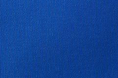 Textile background. Weaved textile background on blue base Royalty Free Stock Photography