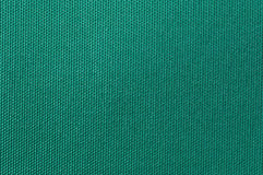 Textile background. Weaved textile background on green base Royalty Free Stock Photography