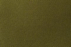 Textile background. Weaved textile background in khaki Stock Image