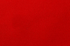 Textile background. Weaved textile background on red base Stock Images