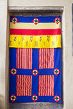 Textile of Bhutan. A Bhutanese textile used for door decoration. Textile of Bhutan represent a rich and complex repository of a unique art form. Plain weave stock photo