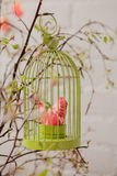 Textile bird in birdcage Stock Photo