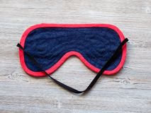 textile blindfold on wooden table royalty free stock photos
