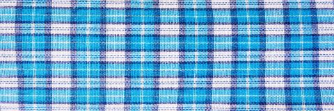 Textile blue box, fabric blue plaid cover. Blue classic checkered pattern. blue checkered fabric closeup , tablecloth texture. Textile blue box, fabric blue Royalty Free Stock Image