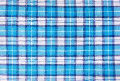 Textile blue box, fabric blue plaid cover. Blue classic checkered pattern. blue checkered fabric closeup , tablecloth texture. Textile blue box, fabric blue Stock Photos