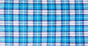 Textile blue box, fabric blue plaid cover. Blue classic checkered pattern. blue checkered fabric closeup , tablecloth texture. Textile blue box, fabric blue Stock Image