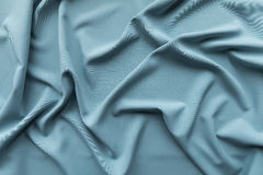 Textile blue grey fabric folds and drapes. Textile blue grey fabric folds Stock Photography
