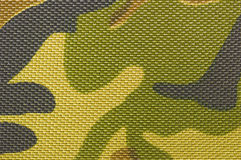 Textile camouflage background. Textile camouflage in green, yellow, brown and khaki Royalty Free Stock Photos