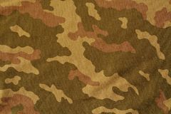 Textile camouflage uniform color background pattern. Stock Photo