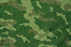 Textile camouflage uniform color background pattern. Royalty Free Stock Photos