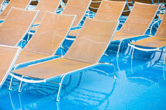 Textile chairs on wet deck of cruise liner Stock Photography