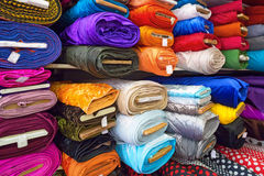 Textile and cloth. Rolls of textile, cloth and tissue of various colours on the market Royalty Free Stock Photos