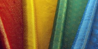 Textile colorful material in India. Red, yellow, green, blue stock images