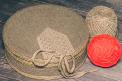 Textile covered box with red yarn and twine Stock Photos