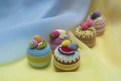 Textile cupcakes on blue and yellow Royalty Free Stock Images