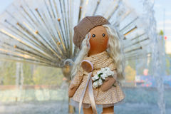 Textile doll with real hair dressed in a beige dress and a beret Royalty Free Stock Images