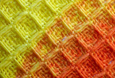 Textile fabric. Macro pattern of yellow - red textile fabric Royalty Free Stock Photography