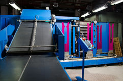 Textile fabric manufacturing machines in work. Stock Photos
