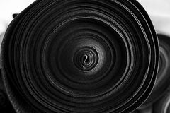 Textile fabrics. Roll Of black Fabric, Side View Royalty Free Stock Images