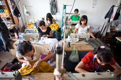 Textile factory. Workers in a textile factory in asia Royalty Free Stock Photo