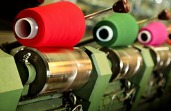 Textile factory. Industrial textile factory, colorful threads stock photography