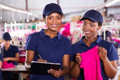 Textile factory co-workers Stock Images
